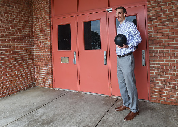 Jared Young, of Employer Advantage, stands outside the old Carl Richards Bowling Alley on Rangeline on Tuesday. The company is renovating the 30,000 sq. ft. building for office space to use as the comapny's new headquarters.<br /> Globe | Laurie SIsk