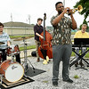 Trumpet player Freddie Green leads a jazz quartet comprised of Adam Holderbaum (drums,) Josh Newburry (bass) and Bob Ensor (keyboards) during the East Town Dreams District Connecting to the Community event on Saturday at Joe Becker Stadium. The event also included games, food and  local emergency responders. Sponsors included Liberty Utilities, Missouri Southern, Me's Place, City of Joplin, One Joplin and Sharon Beshore.<br /> Globe | Laurie Sisk