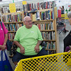 Charlotte and Ronald King, Habitat homeowners, talk with Linda Russow, right, during Joplin Habitat for Humanity's 30th anniverary party at the Habitat ReStore on Thursday.<br /> Globe | Roger Nomer