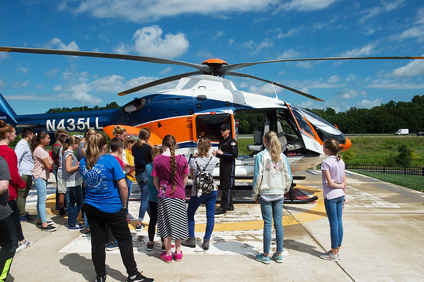 Travis Neher, flight paramedic with Mercy Hospital, gives a tour to the MASH Camp on Monday at Mercy Hospital.<br /> Globe | Roger Nomer