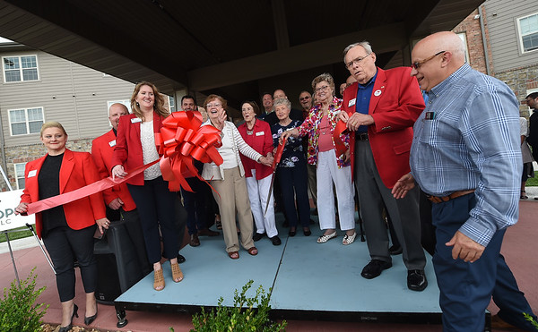 Representatives from Wildwood Senior Living and the Joplin Area Chamber of Commerce gather to celebrate the opening of the senior living complex on Wednesday.<br /> Globe   Laurie Sisk