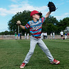Braydon Korth, 9, practices his pitching delivery during the Outlaws youth camp on Wednesday at Joe Becker Stadium.<br /> Globe | Roger Nomer