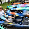 Six-year-old Kaylen Curry checks out one of the kayaks from Ozark Mountain Trading Company during the Outdoor Demo Swap and Meet on Saturday at Wildcat Glades. The event featured kayaks, food trucks and more. The event was sponsored by Joplin Outdoor Adventures.<br /> Globe | Laurie Sisk