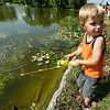 Four-year-old Chester Forste, of Carthage, waits patiently for a bite from a fish during the annual Kids Fishing Day on Saturday at Carthage's Kellogg Lake. The annual event featured free fishing, educational booths, free lunch and more.<br /> Globe | Laurie Sisk