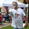 Tom Workman, of Neosho, perfects his cornhole skills during Celebrate Neosho on Saturday on the Neosho Square. The event kicks off a host of Fourth of July events in the Four State area.<br /> Globe | Laurie Sisk