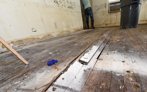 Buckled floorboards illustrate the damage caused by recent flooding to  a house on the 1100 block of Central Ave. in Miami on Wednesday.<br /> Globe | Laurie SIsk