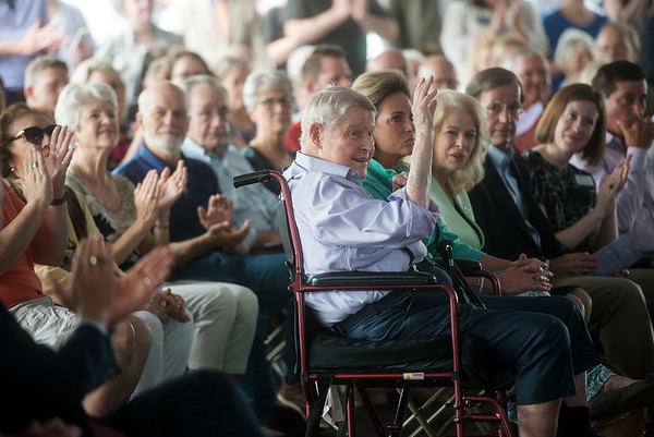 Harry Cornell waves as he is applauded for his contribution to the Cornell Complex on Monday at Memorial Hall.<br /> Globe | Roger Nomer