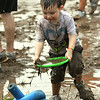 Four-year-old Florida transplant Damien Nabors, now of Carthage, enjoys his first Mudstock on Saturday at Myers Park in Carthage. Nabors family said they have never seen anything quite like the event, which is sponsored by the Alliance of Southwest Missouri.<br /> Globe | Laurie Sisk