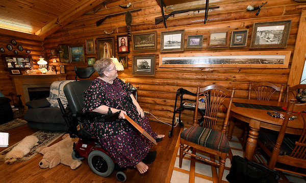 Jeanne Newby, known as the unoffical historian of Webb City, sits near a wall of historic photos of Webb City in her King Jack Park home on Wednesday.<br /> Globe | Laurie Sisk