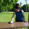 Courtney Whitehead, with Liberty Utilities, scrubs a table at Wildcat Park on Friday during the United Way Day of Action.<br /> Globe | Roger Nomer