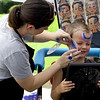 Five-year-old Skylar Clark, of Neosho, gets a patriotic design painted on his face by Sheena Phillips, of Facepainting by Sheena during Celebrate Neosho on Saturday on the Neosho Square. The event kicks off a host of Fourth of July events in the Four State area.<br /> Globe | Laurie Sisk