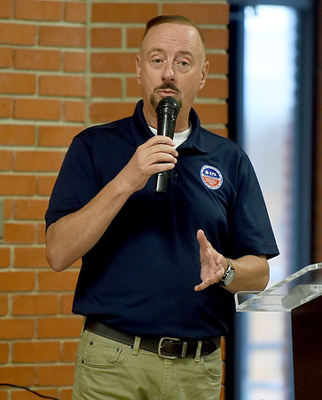 Mike McAteer, EPA Region 6 on-scene coordinator, shares details at an informational meeting at the Miami Civic Center on Thursday night involving the clean up of asbestos at the BF Goodrich plant in Miami. <br /> Globe | Laurie Sisk