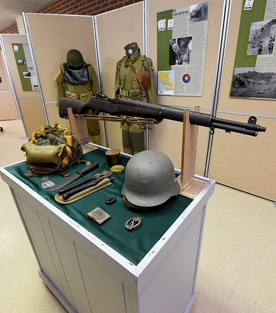 World War II relics, including rifle and helmets stand among the numerous items in a D-Day exhibit on Wednesday at the Joplin Museum Complex in honor of the 75th Anniversary of the invasion of Normandy.<br /> Globe | Laurie SIsk