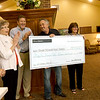 Representatives from the Ronald McDonald House of the Four States and Edward D. Jones past and present employees gather for a presentation of a check for more than $34,000 to the RMH from Edward D. Jones on Saturday at RMH. The money was raised by Edward D. Jones employees in honor of Jim Goodknight and his wife, Barbara Goodnight, who passed recently. The Goodknights were instrumental in the success of the RMH since its inception. From the left: Pat Barr, retired Edward D. Jones employee and former RMH board member, Sharon Dean, RMH board member, Mike Jennings, past president of the RMH board, Gary Brown, RMH board treasurer, RMH Executive Director Annette Thurston and Ron Harp, retired Edward D. Jones employee.<br /> Globe | Laurie Sisk