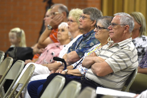 Miami residents listen as Mike McAteer, EPA Region 6 on-scene coordinator, shares details at an informational meeting at the Miami Civic Center on Thursday night involving the clean up of asbestos at the BF Goodrich plant in Miami. <br /> Globe | Laurie Sisk