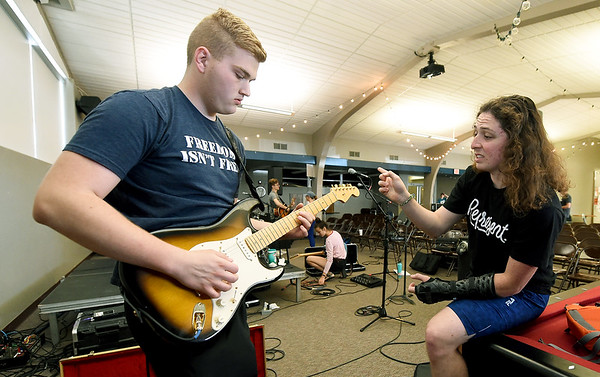 From the left: Baylor Brower, 17, of Webb City gets a little musical advice from Ozark Christian College sophomore Solomon Sanchez, of Dallas, Texas during the OCC Creative Arts Academy on Thursday at the Mabee Student Center. More than 100 high school age students are receiving mentorship from 23 OCC students and 41 faculty and staff on a variety of creative disciplines from writing, to music, photography, film, graphic arts, animation and theatre in the week long program. <br /> Globe | Laurie SIsk