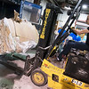 Eric Tune works with recycling at Joplin Workshops on Friday.<br /> Globe | Roger Nomer