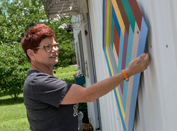 Mary Riley talks about one of her barn quilts at her home in Carthage on Tuesday.<br /> Globe | Roger Nomer