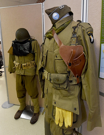 World War II uniforms stand among the numerous items in a D-Day exhibit on Wednesday at the Joplin Museum Complex in honor of the 75th Anniversary of the invasion of Normandy.<br /> Globe | Laurie SIsk