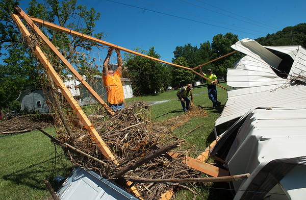 City of Neosho workers (from left) Bo Noah, Kenny Balls and Matthew Brown work on flood-damaged structures in Morse Park in Neosho on Tuesday.<br /> Globe | Roger Nomer