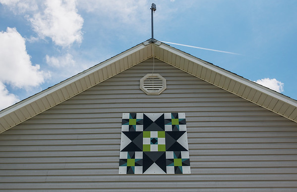 Mary Riley has created several barn quilts, including this one at her home in Carthage.<br /> Globe | Roger Nomer