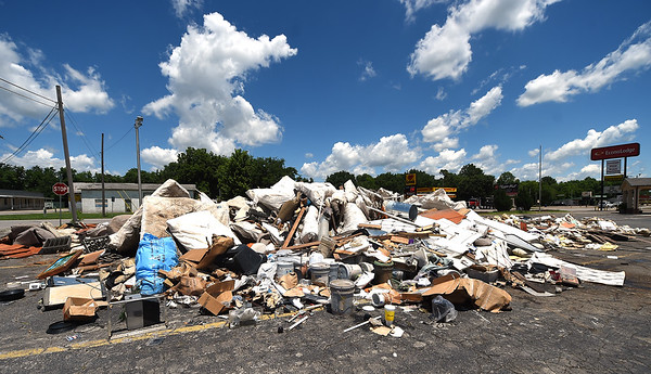 Damaged contents from Miami's Econolodge Motel lay ready for pick up on Steve Owens Boulevard on Wednesday after floods ravaged the area. The pile is about half of its original size after rooms were cleared.<br /> Globe | Laurie Sisk