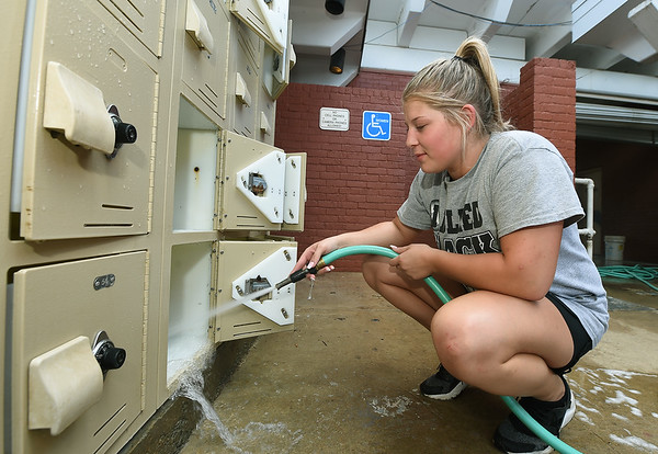 Miami parks worker Karsyn Severs cleans lockers at the Miami City Pool in preparation for opening of the pool , which is targeted for June 22. The pool has yet to open for the season after heavy flooding buried the pool and its grounds.<br /> Globe | Laurie Sisk