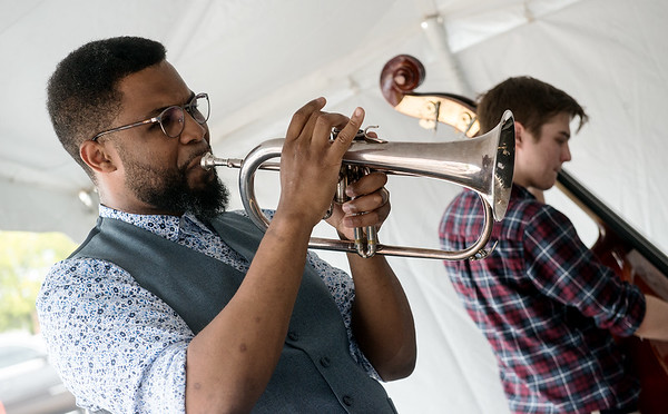 Freddie Green, left, and Josh Newburry play before the launch party of the Cornell Complex on Monday at Memorial Hall.<br /> Globe | Roger Nomer