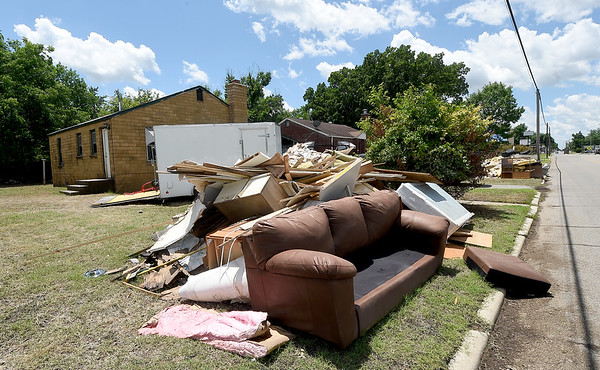 Damaged contents from a residence on the 1100 block of Central Ave. in Miami await haul away on Wednesday.<br /> Globe | Laurie SIsk