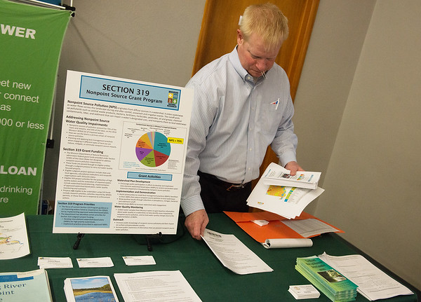 Ron Seyl, project specialist with the Missouri Department of Economic Development Division of Energy, sets up information during Thursday's Missouri Department of Natural Resources financing workshop at the Route 66 Event Center in Webb City.<br /> Globe | Roger Nomer
