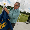 Bruce Mahr raises a flag at the Neosho Patriot Memorial on Wednesday.<br /> Globe | Roger Nomer