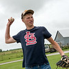 Dylan Gallup, 16, plays catch on Monday at his family's farm in Lockwood.<br /> Globe | Roger Nomer