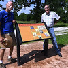 Steve Maddox, left and Larry Wood stand next to a kiosk that details the rich history of the Sherwood-Rader Farm last week near Carl Junction.<br /> Globe | Laurie SIsk