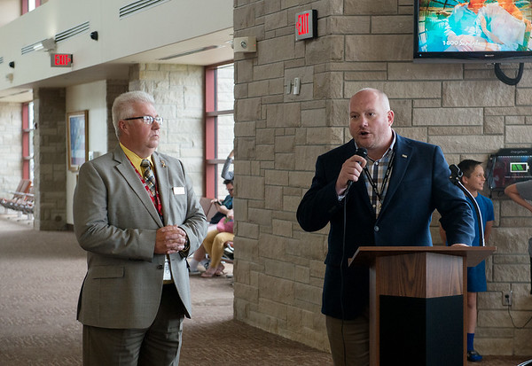 Steve Stockam, manager of the Joplin Regional Airport, left, and Eric Montgomery, regional manager with American Airlines, speak before the arrival of the Chicago flight to the airport on Thursday.<br /> Globe   Roger Nomer