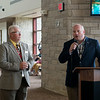 Steve Stockam, manager of the Joplin Regional Airport, left, and Eric Montgomery, regional manager with American Airlines, speak before the arrival of the Chicago flight to the airport on Thursday.<br /> Globe | Roger Nomer
