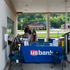 US Bank staff in Neosho work outside their building on Friday.<br /> Globe | Roger Nomer