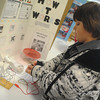 Globe/Roger Nomer<br /> Brian Jimenez, a sixth grader at Diamond Middle School, prepares his science exhibit at the Missouri Southern Regional Science Fair on Tuesday.