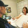 Globe/Roger Nomer<br /> Randall St. Pierre, a resident in the FEMA housing, gets help with a form from Tara Johnston, night administrative assistant, at the Human Services Campus on Wednesday.