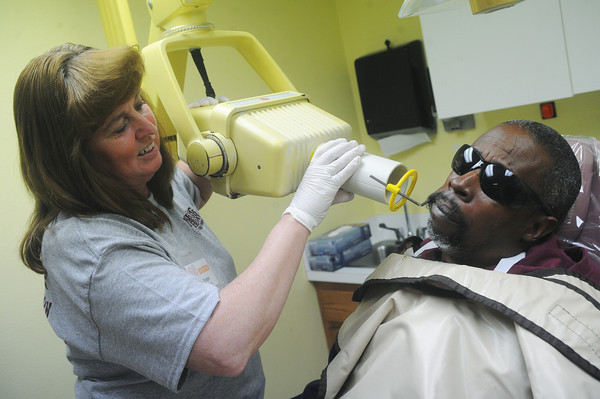 Globe/Roger Nomer<br /> Bridget Kavanagh takes a x-ray of Michael Obie, Carthage, during the Good Friday Free Dental Clinic.