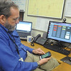 Globe/Roger Nomer<br /> Keith Stammer, director Joplin/Jasper County Emergency Management, uses his mobile phone to get weather information.  Stammer recommends residents use phones as a resource for weather warnings.