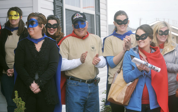 Globe/Roger Nomer<br /> Members of the Justice League dressed in capes and masks for the dedication of 2630 Wall on Wednesday.