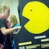 Globe/Roger Nomer<br /> Breanna Slavens, a sixth grader at Neosho Middle School, plays Pac-Man video game at an exhibit at Missouri Southern for the annual History Day.