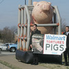 Globe/Roger Nomer<br /> Mercy for Animals members Nick Wallerstedt, left, and Phil Letten protest Walmart's treatment of pigs at the West Seventh Street store on Tuesday.