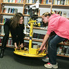 Globe/Roger Nomer<br /> Elizabeth Peterson, seventh grade, helps Karen Kosiba, from the Center for Severe Weather Research, demonstrate how a weather pod is deployed during a visit to East Middle School on Thursday.