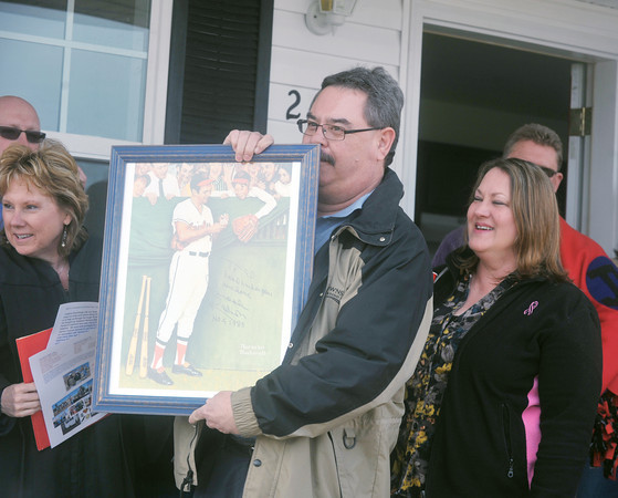 Globe/Roger Nomer<br /> Ed Kunce displays a signed print of Brooks Robinson he received as a housewarming gift at the 2630 Wall dedication on March 13, 2013.