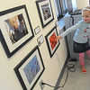 Globe/Roger Nomer<br /> Adelaide Davidson, 4, Joplin, points out her photo for her family during the opening of the PhotoSpiva Kids exhibit on Sunday.