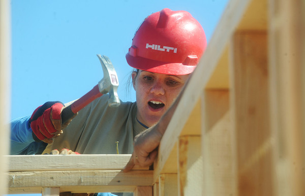 Globe/Roger Nomer<br /> Katrina Richards gets acquinted with the skill of hammering nails during the first day of construction at 2630 Wall.  Richards, with Hershewe Law Firm, was one of the active members of the Justice League.