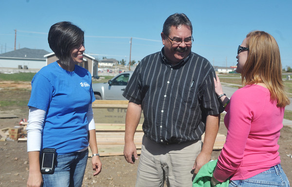 Globe/Roger Nomer<br /> Laura Edwards, Joplin Habitat volunteer coordinator, left, and Sarah Schneider a vollunteer with Thrivent Builds from Appleton, Wis., talk with home owner Ed Kunce at the build site during a work day in October.