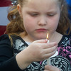 Globe/Roger Nomer<br /> Ally Grigsby, 7, Neosho, tries to keep her candle lit during the unveling of the Freeman Beacon of Hope.