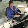 Globe/Roger Nomer<br /> Deb Lauritzen works at the Joplin Police dispatch unit on Monday morning.